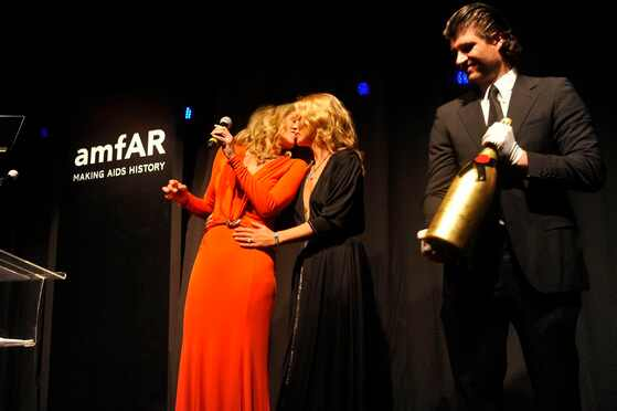 Sharon Stone kisses Kate Moss - amfAR ball in Sao Paulo, Brazil