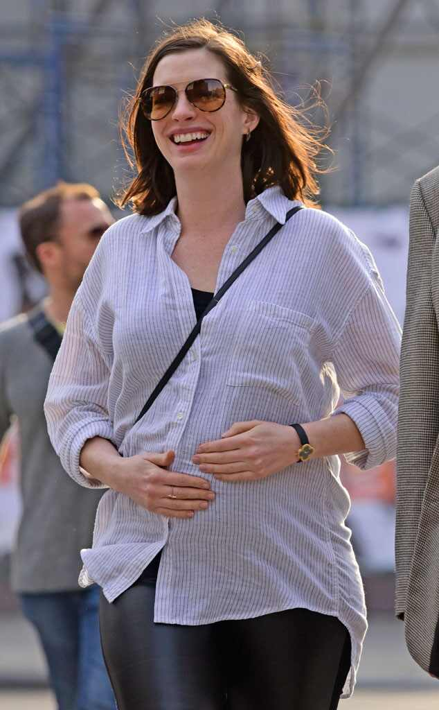 Anne Hathaway Rubs Her Growing Baby Bump in New, Adorable ...